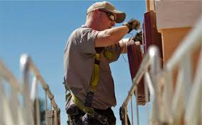 Man repairing sign