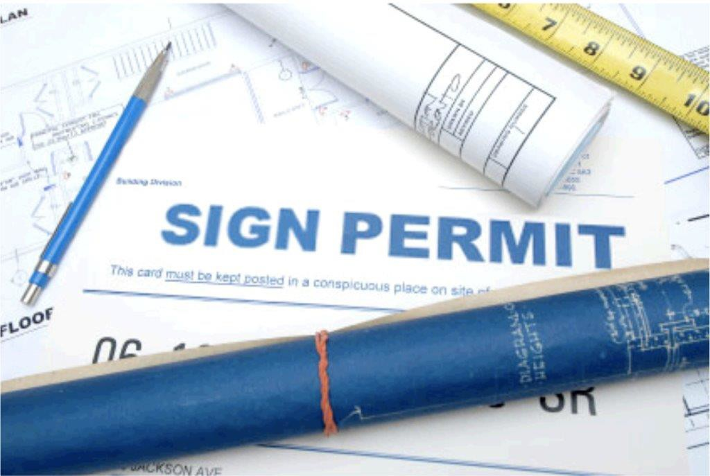 Sign permit on table with ruler