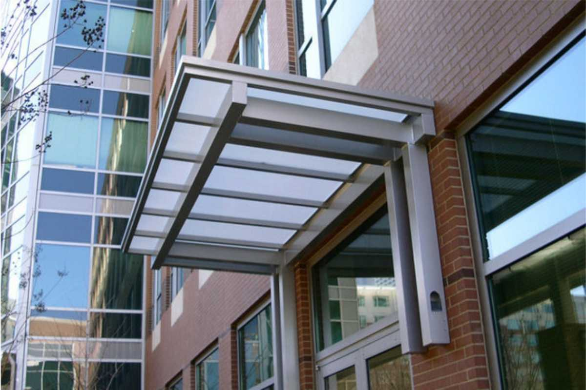 metal and glass canopy over window/ door