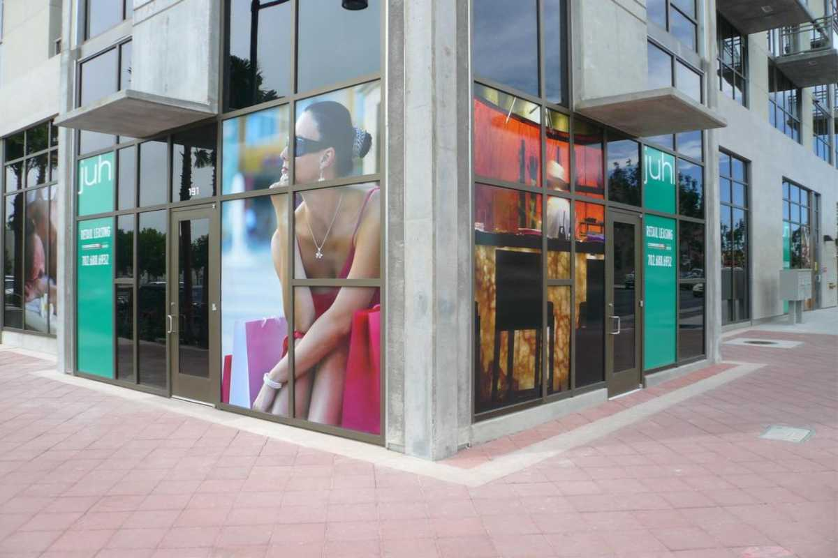 large format digital printing on street corner in window depicting woman sitting in thought