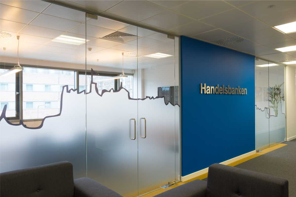 Frosted glass in office with wall sign/ logo/ lettering