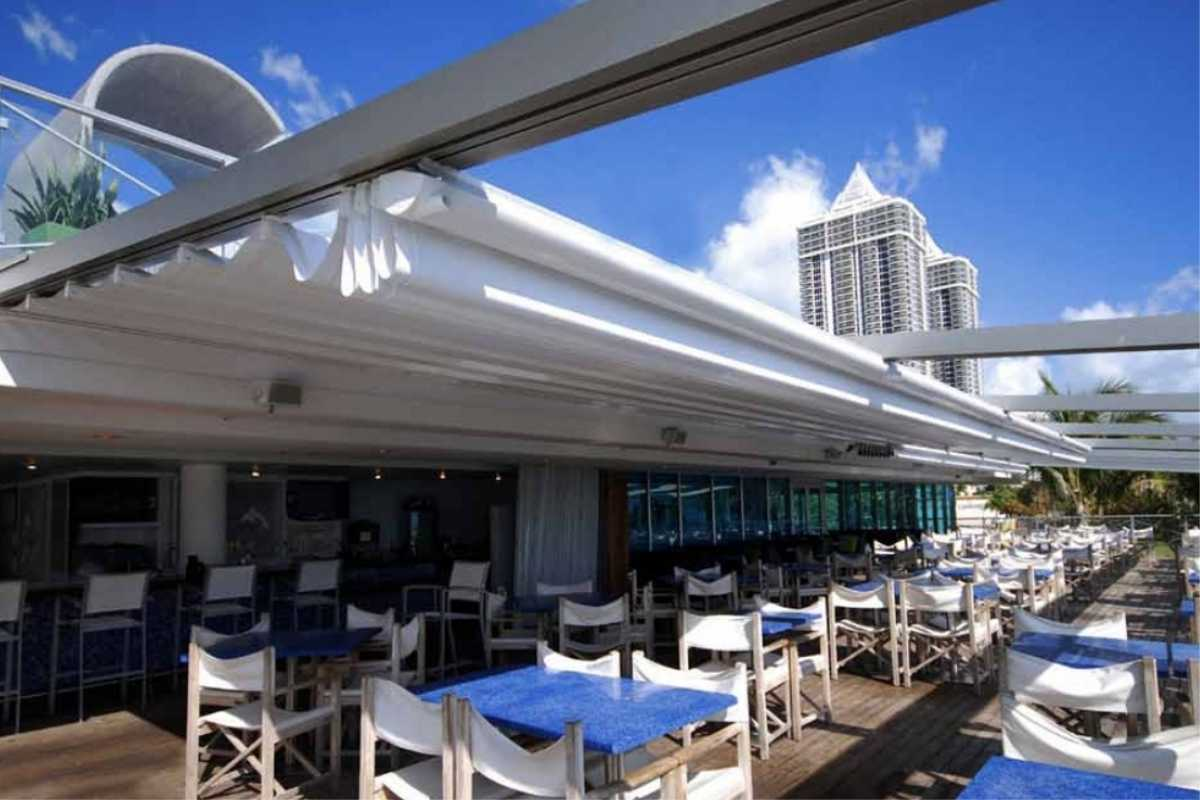 Commercial retractable awning outside dining area