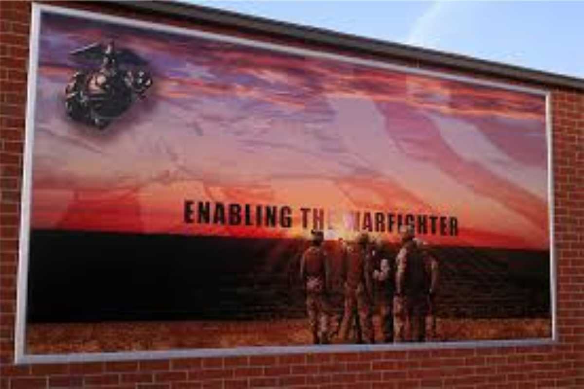 A large wall sign with group of men and the words