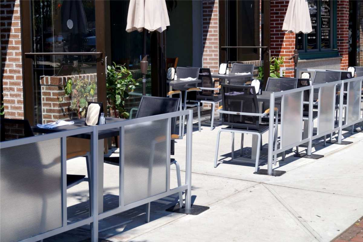 sidewalk barriers defining outdoor eating area