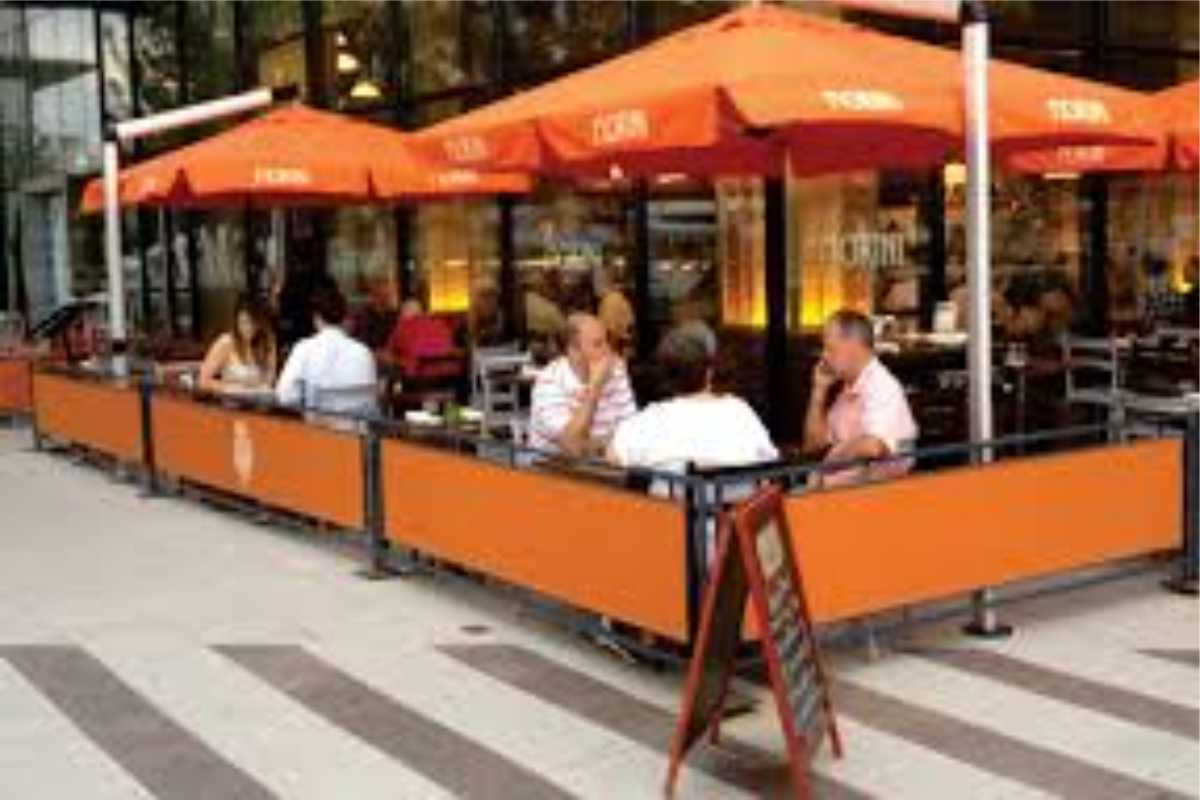 sidewalk barriers outside eating area street cafe